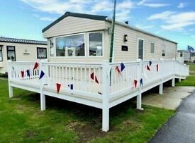 Cheap static caravan for sale , sited in Essex , huge decking beautiful plot
