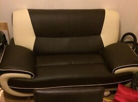 Cream and brown leather sofa