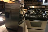 2 years old KitchainAid stainless steel stove / fridge for sale