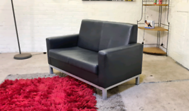 Designer Black Leather 2 Seater Sofa - Like New