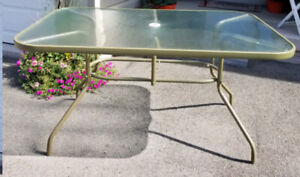 """Patio table 38"""" X 60"""". Delivery available for a small fee If int"""