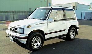 Wanted Geo Tracker Tin Top