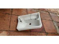 Large vintage bathroom sink including taps