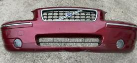 Free to collector Volvo S60 2006 front bumper in metallic red