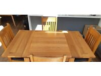 Solid wood Dining room table (extendable) and 4 chairs.