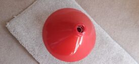 Red plastic Coolie style light shade