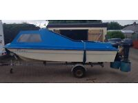 15.5ft Orkney Copy cathedral hull boat with trailer. Comes with 2 engines and extras