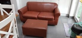 Old leather sofa and foot stool