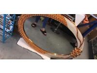 Large oval gold mirror