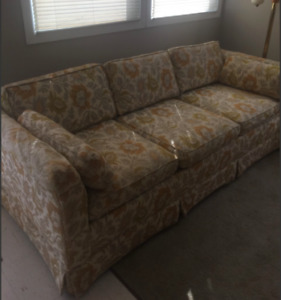 Sofa with hide-a-bed and matching love seat.