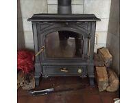 Efel Harmony I Multifuel Stove with stone fireplace surround