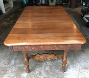 Antique tables with three chairs