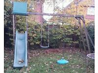 Kids playhouse with swing and slide and monkey bars and climbing wall