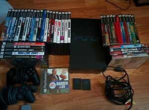 Playstation 2 + 2 Manettes + 2 memory cards + 42 jeux