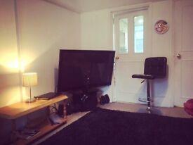 LG TV 50 inches chair , black rug , home cinema
