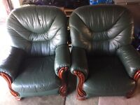 Green leather and wood armchairs