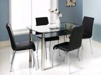 black.glass table with 4 leather chairs
