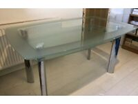 very good condition Heavy duty 2 tier glass top dining table with chrome legs.