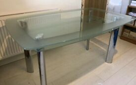 Excellent condition Heavy duty 2 tier glass top dining table with chrome legs.