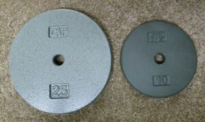 Barbell weights 25 & 10 lb 1 inch hole