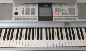 Yamaha DGX 305 keyboard with stand. Excellent condition.