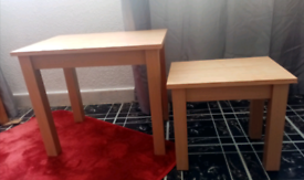 2 different sized wooden side tables