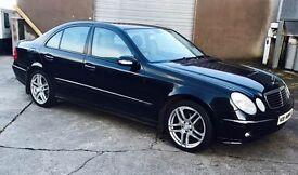 2005 Black E320 Mercedes