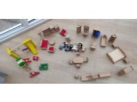 Set of wooden doll's house furniture and family. Good condition.
