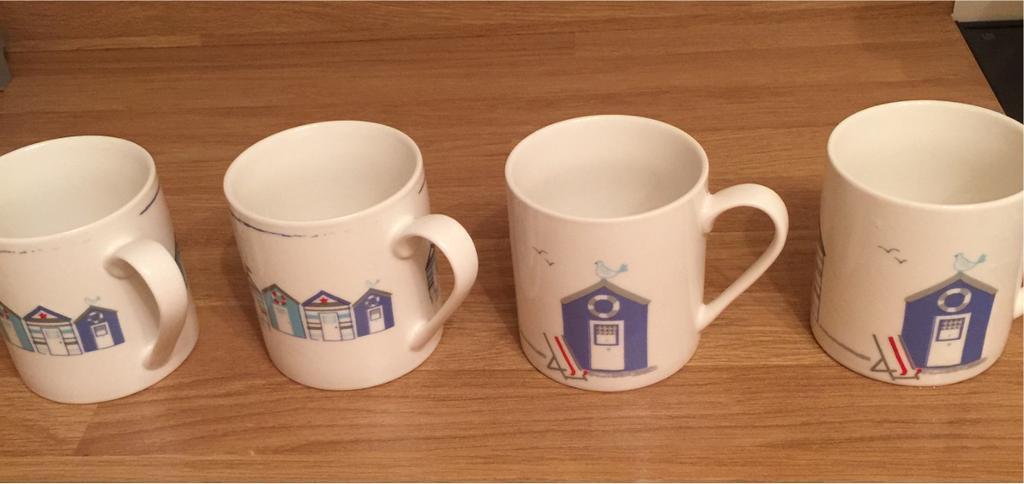 Four Waitrose mugs