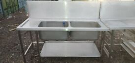 Commercial catering equipment Stainless steel sink and tables restaurant kitchen items