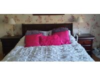 King size sleigh bed and two bedside cabinets