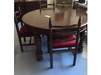 Round oak dining room table and 4 chairs