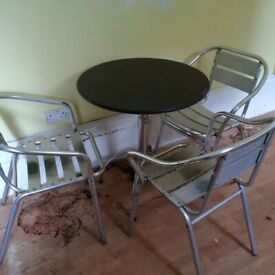 small black granite garden table with three aluminium chairs can deliver