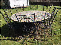 Mosaic table + 8 chairs (wrought iron)