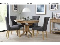 Round extendable pedestal dining table and four chairs