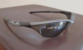 Oakley Half Jacket Sunglasses. Dark Grey with Black Iridium Lenses. Excellent Condition