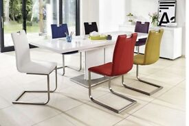 White high gloss extending table with 6 black chairs