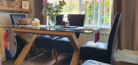 Solid Beech wood and glass Dining Table with 4 padded, leather chairs.