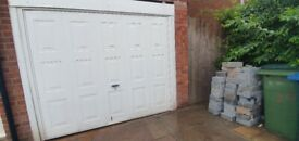 Garage door for sale, with lock and key, used, up and over opening style, light steel, with fittings