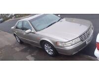 Cheap Insurance as 2. car, 300 bhp Cadillac Seville STS
