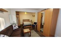 A lovely large garden flat in perfect condition. Own garden with separate kitchen and shower room
