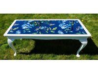 Glass top coffee table in unique design