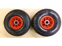 Pair of pneumatic trolley wheels .