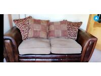DFS fabric and leather couch