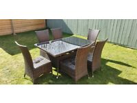 Rattan garden table and six chairs