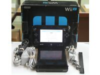 Boxed wii u with lots of games and controller