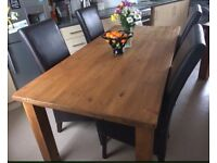 Solid Dining Table and 4 Leather Chairs