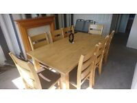 Large 8 seater dinning table and chairs