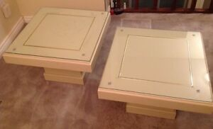 Two side/coffee tables with glass sheet on top