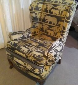 Antique Claw and Ball Armchair with expensive animal print cover